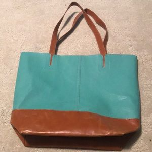 Yea and brown leather tote